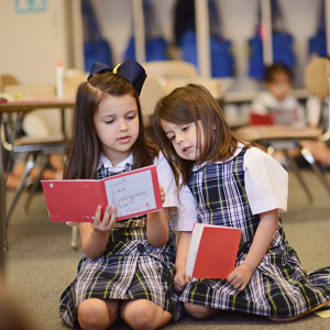 two elementary girls reading